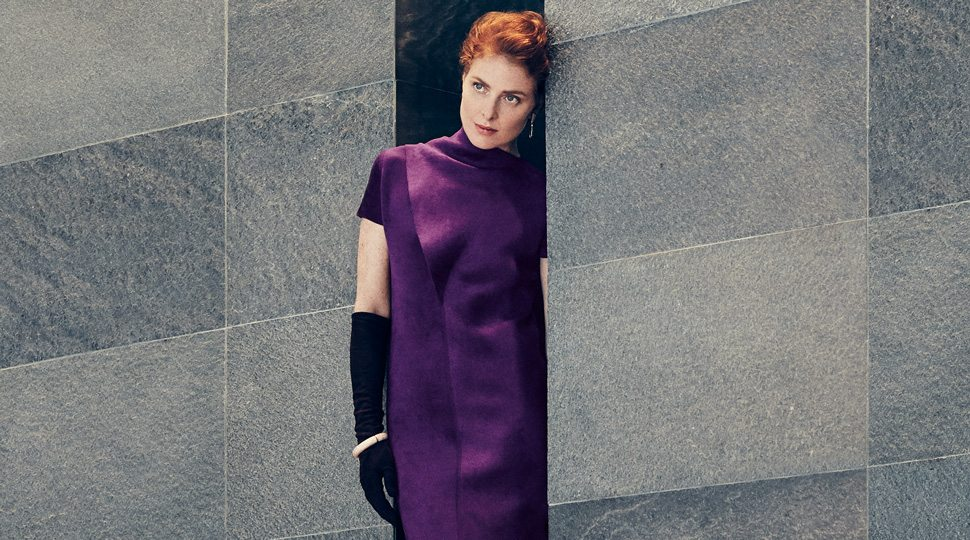Woman in purple dress and black gloves