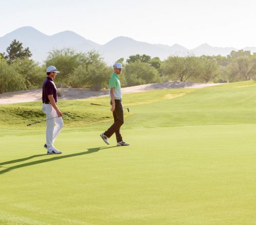 Two golfers walking the course