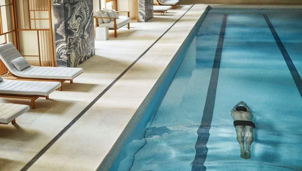 A guest swims in the pool at Four Seasons Hotel New York Downtown