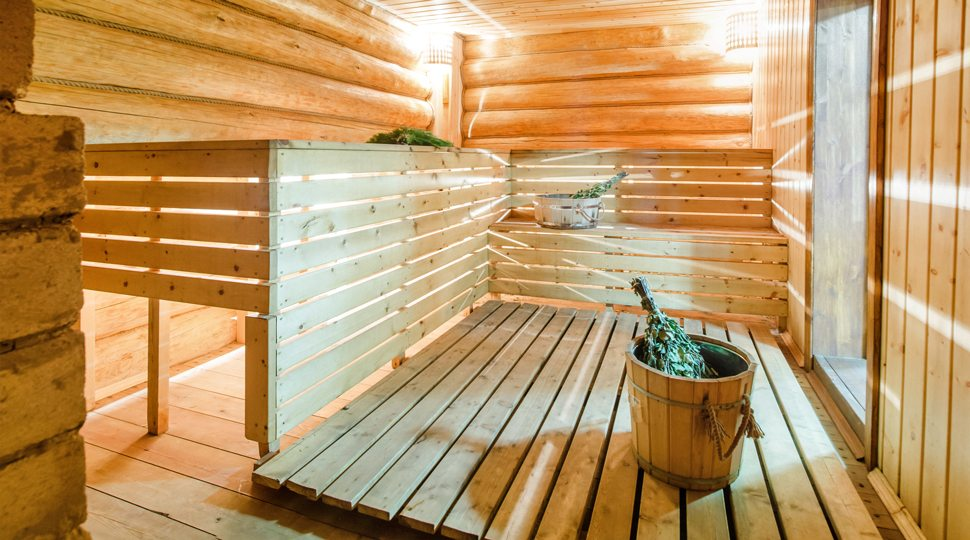 A Russian Banya with traditional water and birch broom