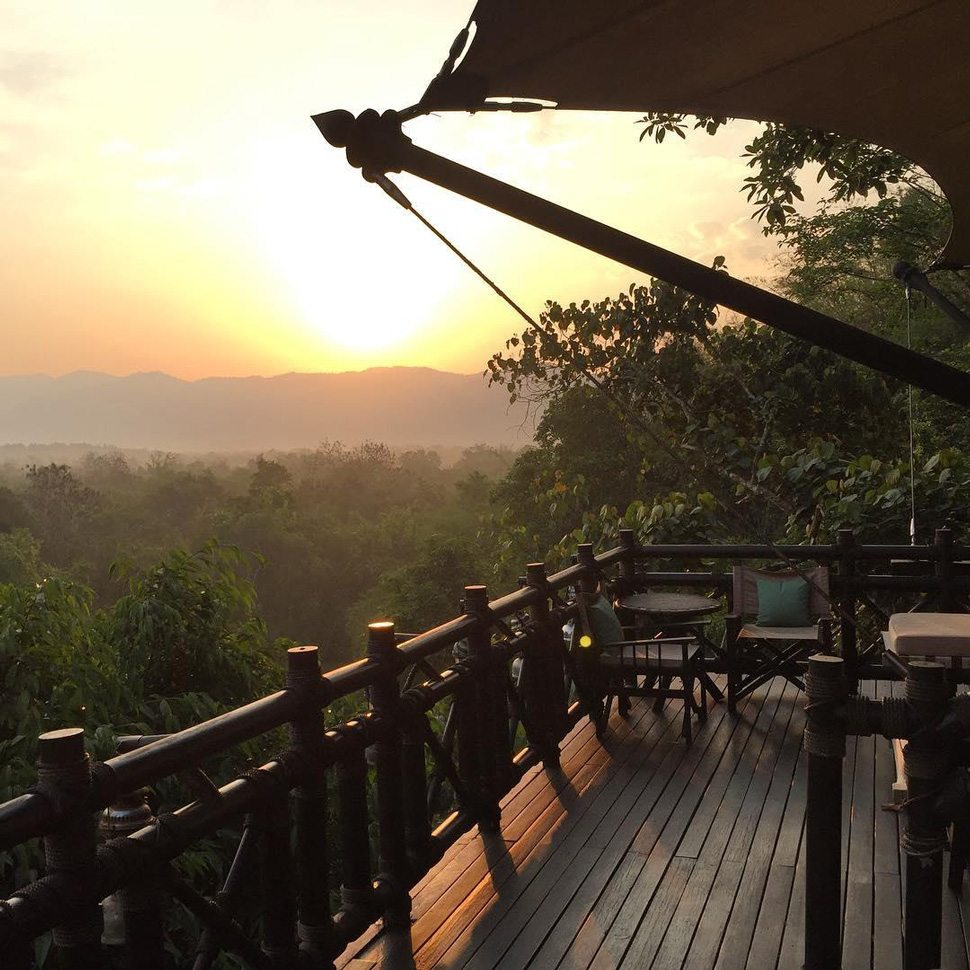 Golden Triangle balcony with view of sunset and jungle
