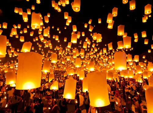 Lanterns illuminate the night sky during the Yi Peng Festival in Chiang Mai.