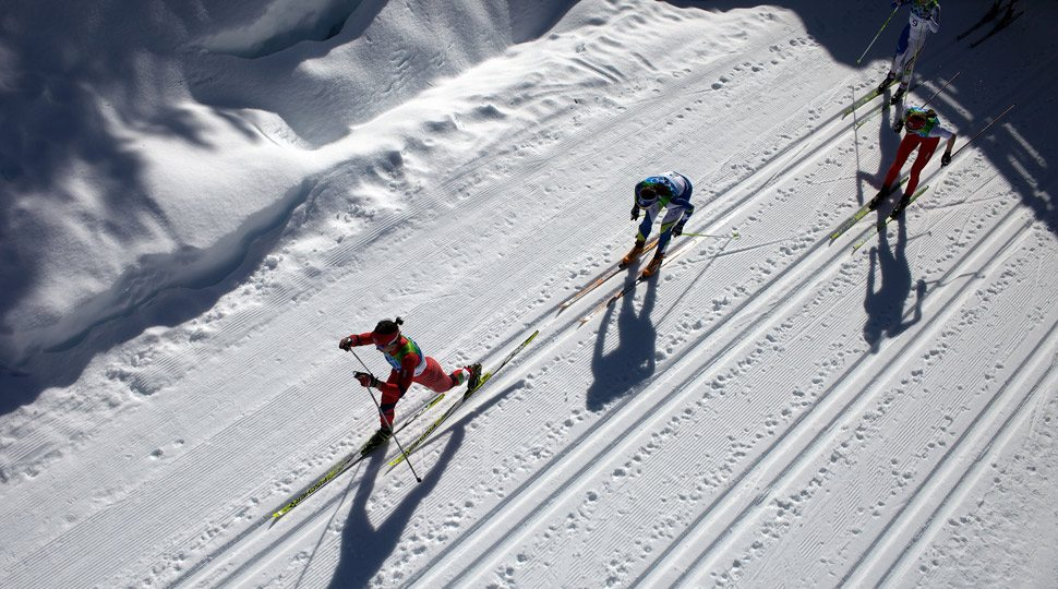 Olympic athletes compete in a ski competition.