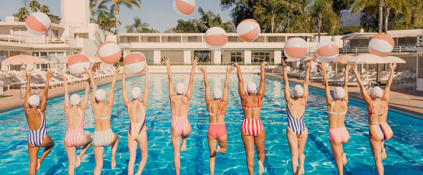 Group of women jump into a pool