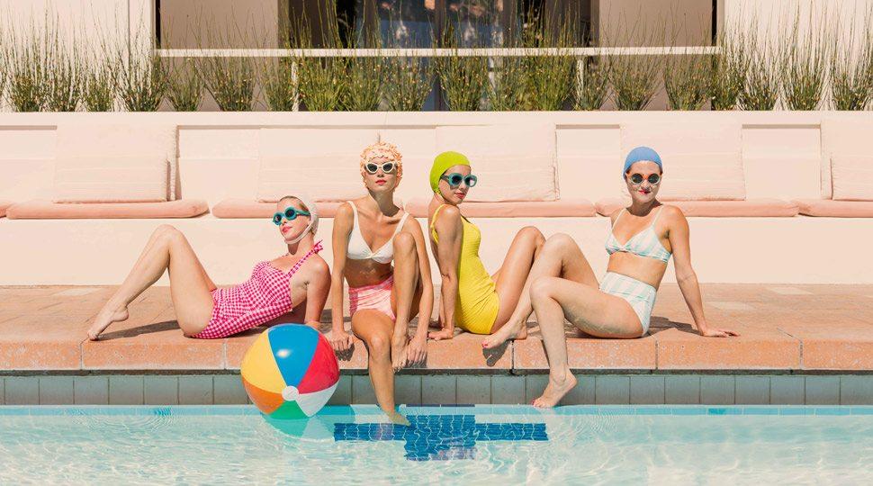 Four women poolside