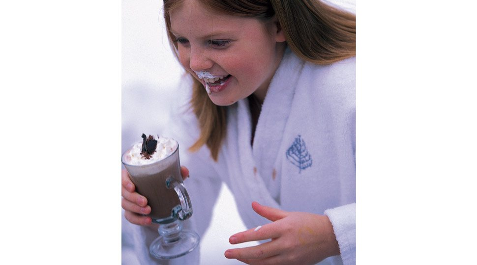 Young girl drinking hot cocoa