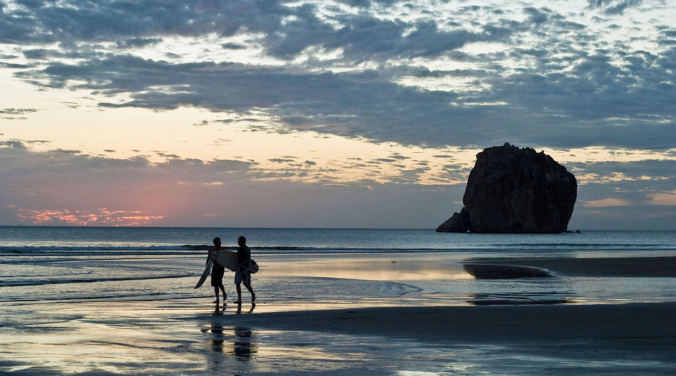 Two Surfers at Witch's Rock in Costa Rica