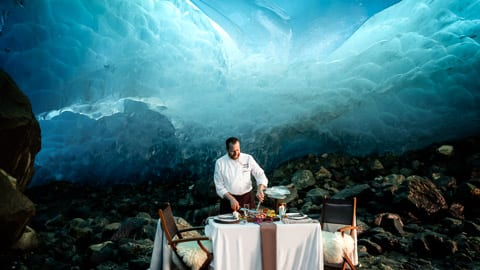 Journey into the depths of ancient, glassy ice caves for an unforgettable dinner