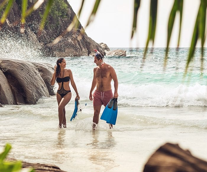 Seychelles beach couple