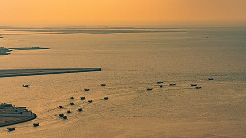 Shrimpers in Bahrain Bay at sunset