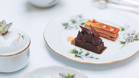 Lavish cakes and savoury delights served on hand-painted Herend porcelain