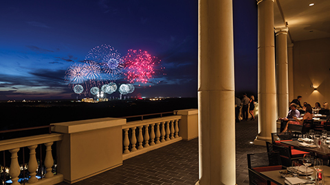 Magic Kingdom® Park evening fireworks show from the terrace rooftop