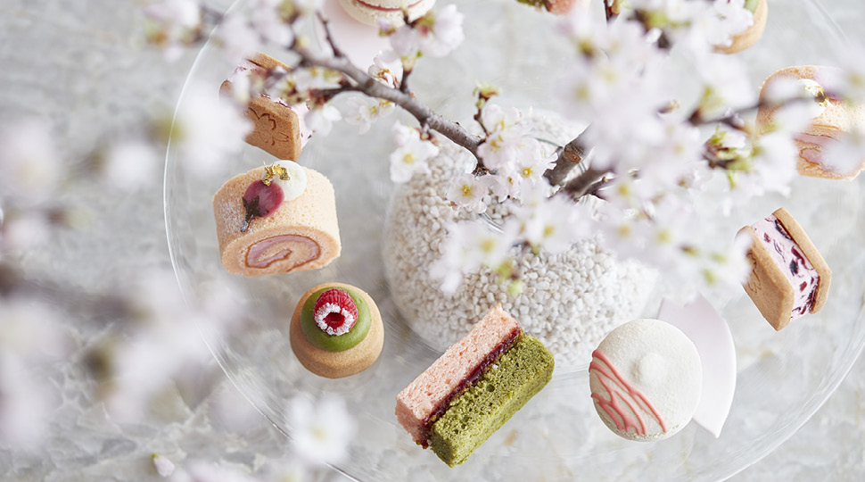 Close up of pastries surrounded by cherry blossom flowers