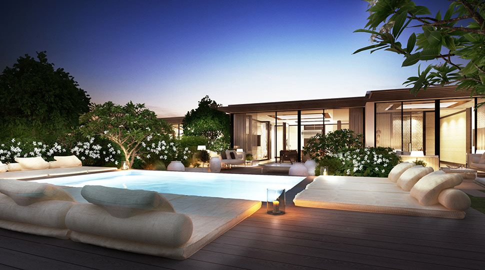 Night-time view of a private pool and villa