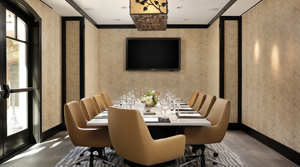 Meeting room with yellow chairs and chandelier
