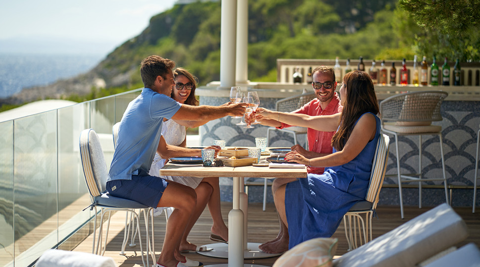 Couples dining on a terrace