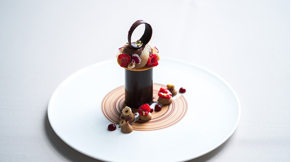 A chocolate dessert on a white plate